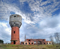 Ruins of old water-tower. On a background autumn landscape Stock Photos