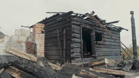 The ruins of an old wooden house destroyed by fire