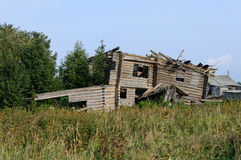 Ruins of old wooden house in the village Royalty Free Stock Image