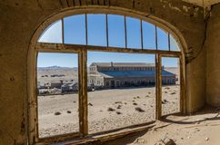 Ruins of once prosperous German mining town Kolmanskop in the Namib desert near Luderitz, Namibia, Southern Africa.  royalty free stock image