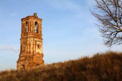 Ruins of Orthodox old church of red brick and wood against the backdrop of the landscape and the blue sky in the morning stock images