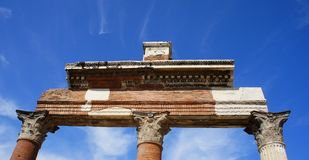 Ruins of Pompei. Three columns made of bricks Stock Photography