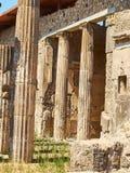 Ruins of Pompeii, ancient Roman city. Pompei, Campania. Italy. Colonnade in courtyard of Domus Pompei in Via della Abbondanza at Ruins of Pompeii. The city was Stock Photo