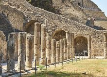 Ruins of Pompeii, ancient Roman city. Pompei, Campania. Italy. Colonnade of Quadriportico at Ruins of Pompeii. The city was an ancient Roman city destroyed by Stock Photos
