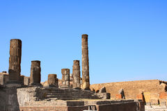 Ruins of Pompeii, Italy, Europe. Ancient columns. On blue sky background Stock Images