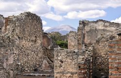 Ruins of Pompeii in Italy. With the volcano Vesuvius in the background in a blue sky Royalty Free Stock Photos