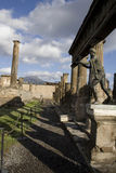 Ruins of Pompeii. A statue and pillars left standing in Pompeii Royalty Free Stock Photos