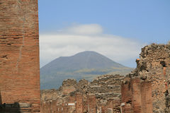 POMPEII RUINS WITH MT. VESUVIUS. A view over the ruins of Pompeii with the Mount Vesuvius on the background Royalty Free Stock Photo
