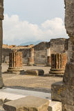 Ruins of Pompeii. Pompeii was an ancient Roman town-city near modern Naples, in the Campania region of Italy, in the territory of the comune of Pompei. Pompeii Stock Photo