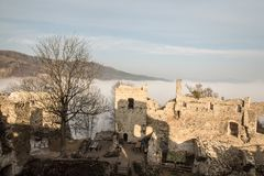 Ruins of Povazsky hrad castle in Slovakia with tree snd hill on the background. Ruins of Povazsky hrad castle above Povazska Bystrica city in Slovakia with tree stock image