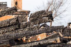 Ruins and remains of a burned down house Stock Photo