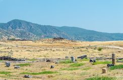 Ruins, remains in the field in the background of the hills of the ancient city of Hierapolis stock images