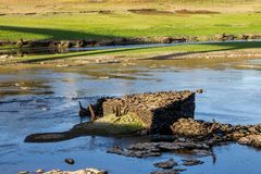 Ruins in the reservoir. Ruins on the bottom of a dry reservoir in Portomarin, Northern Spain Royalty Free Stock Image