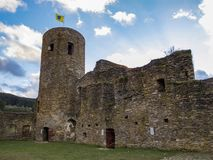 The ruins of Reuland Castle before sunset, at Burg-Reuland Belgium stock images