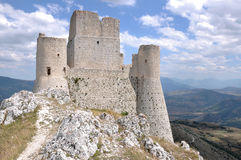 Ruins of rocca calascio fortress, abruzzi. Ruins of ancient fortification in barren landscape of apennines high mountains Stock Photos