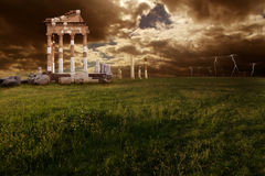 Ruins roman. Ancient roman ruins under cloud darkness sky Royalty Free Stock Images