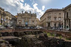 Ruins of the Roman Amphitheater at the Stesicoro Square with San Biagio Church on background - Catania, Sicily, Italy Stock Image