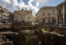 Ruins of the Roman Amphitheater at the Stesicoro Square with San Biagio Church on background - Catania, Sicily, Italy Stock Photos