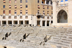 Ruins of Roman amphitheatre downtown in Lecce, Italy Stock Photos