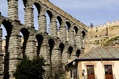 Ruins of Roman Aqueduct in Segovia Spain. Roman ruins of ancient Aqueducts in Segovia Spain with a blue sky background royalty free stock photography