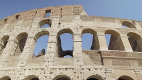 Ruins of the Roman Colosseum. Vehicles and people, left to right pan shot stock footage