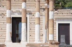 Ruins of the roman temple called Capitolium or Tempio Capitolino in Brescia Italy. Stock Images