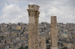 Ruins of roman Temple of Hercules on the Amman citadel with city Stock Images