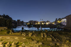 Ruins in Rome at Night. Ruins in central Rome at night showing the remains of various old buildings Stock Photos