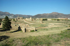 Ruins in roses. Tree grass and ruins under blue sky in roses spain Royalty Free Stock Photos