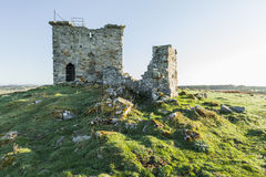 Ruins of Rothley Castle, Northumberland. England.UK. Ruins of Rothley Castle set on top of a moorland hill top in rural Northumberland Stock Photography