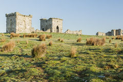 Ruins of Rothley Castle, Northumberland. England.UK. Ruins of Rothley Castle set on top of a moorland hill top in rural Northumberland Stock Images
