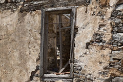 The ruins, the ruins of the destroyed castle fortress wall with a window with iron bars. Royalty Free Stock Photos