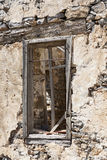 The ruins, the ruins of the destroyed castle fortress wall with a window with iron bars. Royalty Free Stock Image