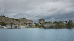 Ruins in Rummu quarry. Abandoned Rummu quarry filled with water. Estonia. September. Cloudy weather Stock Photo