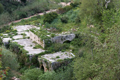 Ruins and River. Ruins in rural Lebanon with a murky river snaking on the side Royalty Free Stock Images