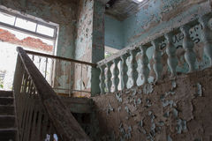 The ruins of the sanatorium. Staircase with a balustrade in the destroyed building of the sanatorium Stock Photography