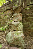 Ruins of sandstone walls of historic mill in Manchester, Connecticut. Buttress in sandstone wall of ruins of E.E. Hilliard's 19th century hydroelectric station Stock Photo