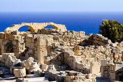 Ruins by the sea. Beautiful scenery of the ruins of arches on a rock by the sea. / Ruins by the sea / Curion, Cyprus Stock Images
