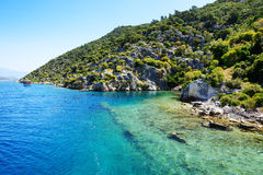 Ruins on on the shores of Kekova Island and yacht Stock Photos