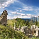 Ruins of Sklabina Castle. And manor house in countryside with blue sky and cloudscape background, Sklabinsky Podzamok, Turiec, Slovakia Royalty Free Stock Images