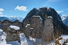 Ruins in snow-covered mountainous landscape Stock Images