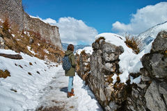 Ruins in snow with woman hiking Royalty Free Stock Images