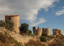 Ruins in Spain. Ruins of landmark towers in Javea southern Spain with interesting side lighting stock image