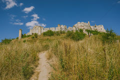 The ruins of Spis castle, Slovakia. Spis castle, Slovakia - one of the largest castle sites in Central Europe was included in the UNESCO list of World Heritage stock images