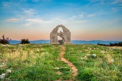 The ruins of St Mark`s chapel Sveti Marek at dusk stock image