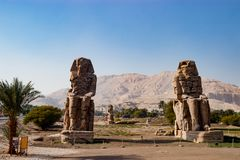 The ruins of statues in Luxor, Egypt stock images