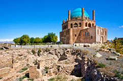 Ruins of stone citadel and historical mausoleum Dome of Soltaniyeh background Stock Image