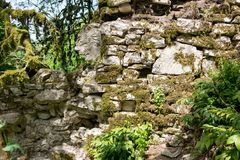 The ruins of the stone walls of ancient fortress stock images