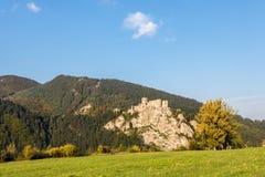 Ruins of Strecno castle in autumn landscape under blue sky Stock Images