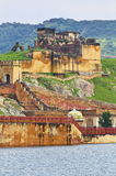 Ruins Structure Inside Amber Fort. Ruins building inside Amber Fort complex with jaipur city in background.Rajasthan royalty free stock images